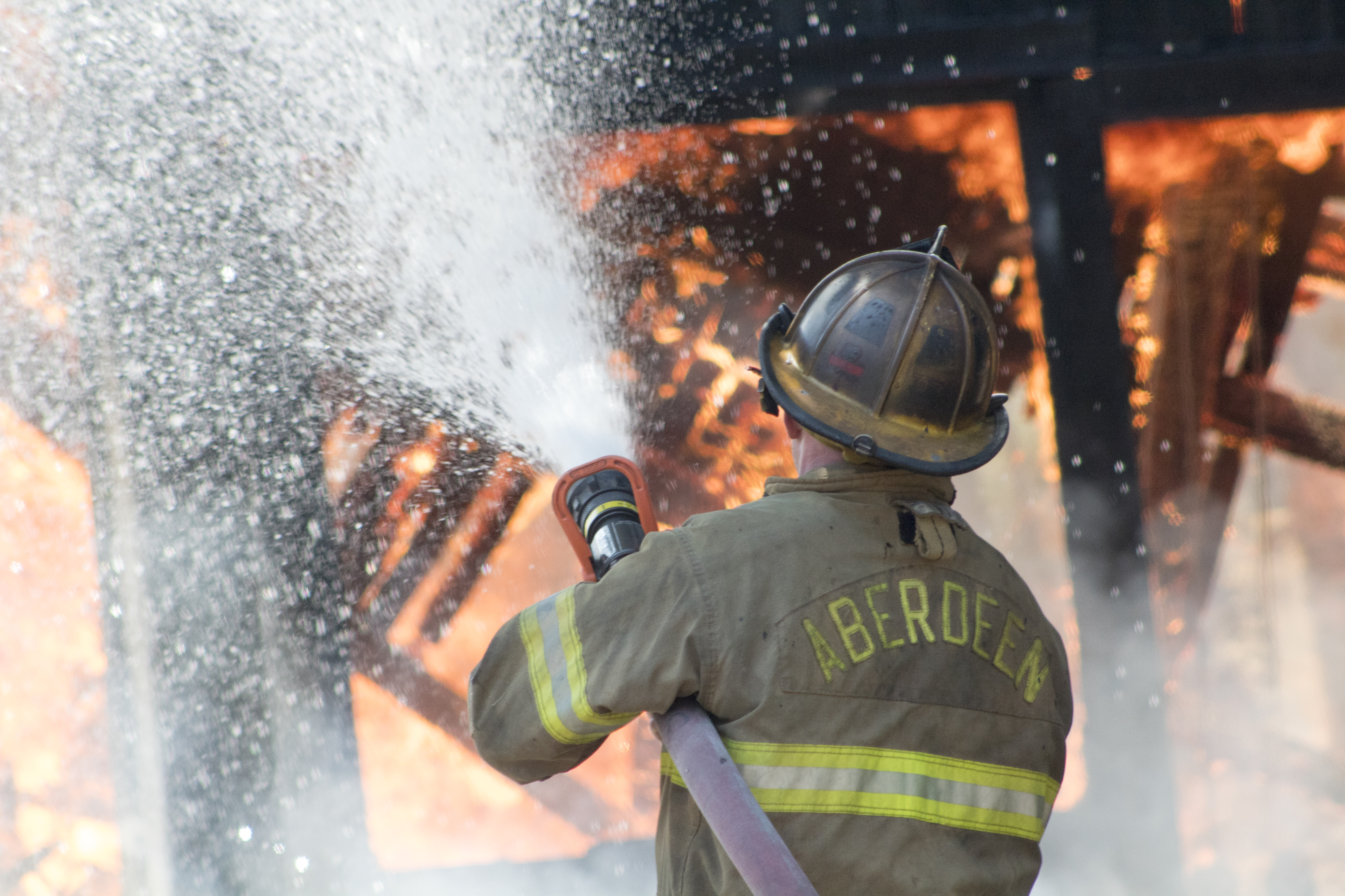 Aberdeen Firefighter Douses Burning Building