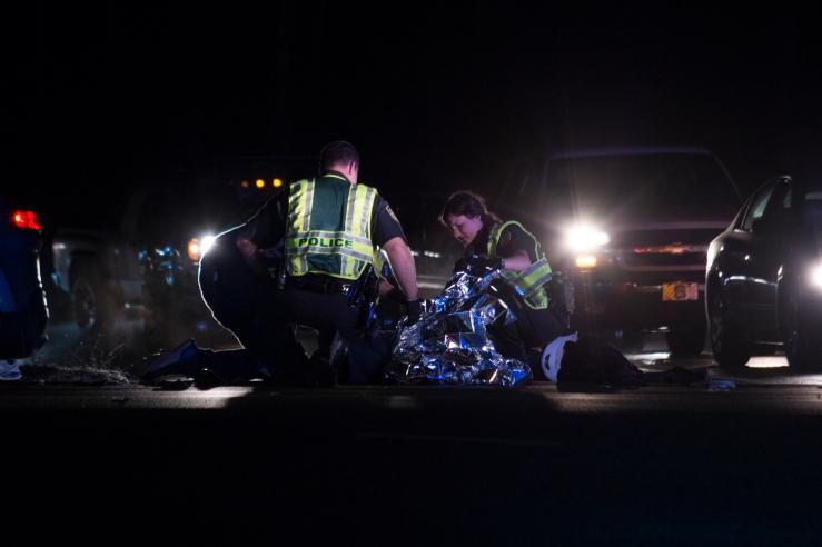Police Place Blanket Over Injured Motorist
